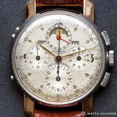 Face Time - Take a look at our fantastic vintage steel & rose gold Universal Genève Tri-Compax Triple Calendar Chronograph from circa 1942 - Find it now at http://ift.tt/1qIwSwQ