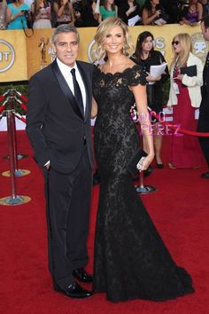 George Clooney and his (current) girlfriend, Stacy Keibler.  Stacy is wearing an amazing Marchesa gown.  This whole look is just gorgeous.