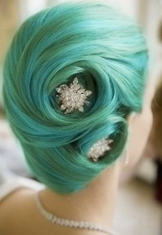 interesting wedding hair, but love the colors: teal green and minty blue