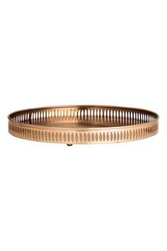 Round metal tray: Round metal tray with a perforated rim and metal feet on the base. Diameter 32 cm, height of rim 3 cm.