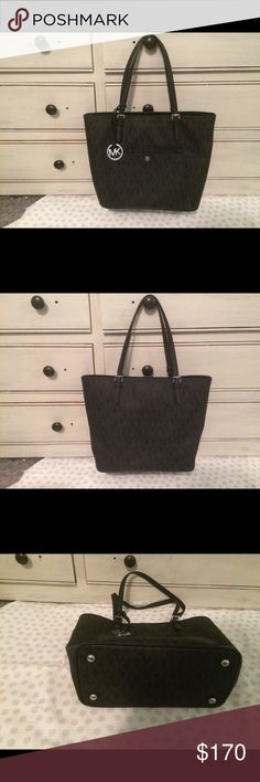 """Authentic Michael Kors Logo Tote❗️just reduced❗️ Michael Kors Large Jet Set Logo Tote barely used in excellent condition inside and out.signature PVC with metal tone hardware, leather trim and a fully lined interior. features two main open pockets, a center zip pocket, an interior zip pocket, 3 interior wall pockets, a cell phone pocket and a keyfob; double leather handles with a 9"""" drop. DiMen'sions: 16"""" x 11.5"""" x 6"""". Michael Kors Bags Shoulder Bags"""