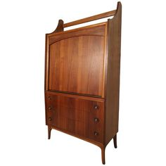 Rare Mid-Century Drop Front Cabinet and Desk   From a unique collection of antique and modern cabinets at https://www.1stdibs.com/furniture/storage-case-pieces/cabinets/