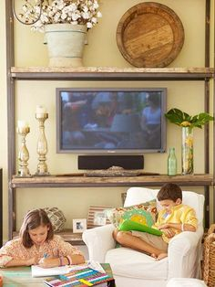 Open display is another opportunity for incorporating a screen into your life. You can suspend it between the shelves or have it sit on a stand, surrounding it with everyday objects so that the television is a planned part of the decor.
