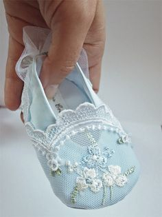 Blue baby shoes with white lace trim. Beautiful!