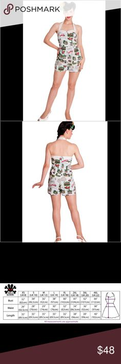 Hell Bunny Souvenir Pinup Playsuit Print is of postcard style imagery with hibiscus flowers, tourist scenes, maps, fish etc. White halterneck strap with buttons at the back to adjust. White contrast collar on the neck edge. Seams over the bust. Waist seam. Pleats in the shorts section. 3 white cotton covered buttons on the centre front bodice. White collar on the back. Seams in the back bodice to shape. Pleats in the back shorts section. Zip in the centre back seam 97% cotton 3% elastane Zip…