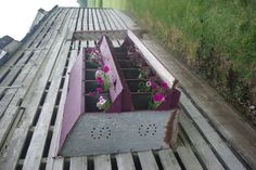 A little can of paint, some ingenuity, dirt and flowers!