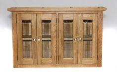 303 - Spacious wall cupboard with glazed doors.