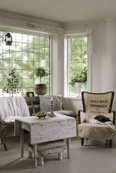 Love so much about this room- the chair, the table, the year above the window on distressed wood.
