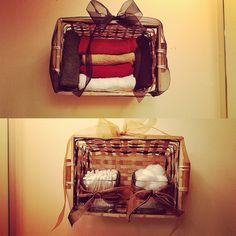 I made these cute baskets to hang on the wall in my bathroom. Super easy, cheap, gets things off the counter and great for decorating wall space. Dollar store baskets, three dollar ribbon, dollar store candle holders to put items in and wash cloths to match your bathroom. Or put what ever you like in there!
