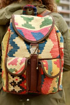Double Pocket Rangin Kilim Backpack. Handmade from bright, bold kilim rugs and finished with high quality brass hardware. Perfect for college, traveling or weekends on the road for the free spirit.