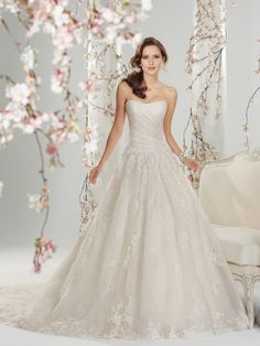Sophia Tolli - Y11416 – Melisandre - Tulle ball gown wedding dress with chapel train, leave a lasting impression with this beautiful misty tulle and lace ball gown. Melisandre features a gently scooped strapless neckline and delicately draped tulle on a French couture-inspired corset bodice. A garland of lace appliqués highlight the subtly dropped waist and are also scattered throughout the full sweeping skirt with chapel length train.