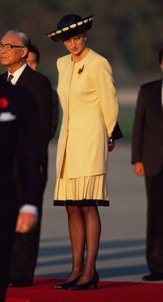 Princess Diana was dressed in a yellow suit on her arrival at Seoul Airbase in November 1992