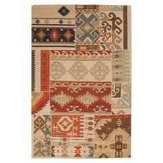 Add a captivating focal point to your home with this beautifully crafted rug, perfect for defining a cozy seating arrangement or anchoring your d�cor.  Product: RugConstruction Material: 100% New Zealand woolColor: MultiFeatures: HandmadeDimensions: 5 x 8Note: Please be aware that actual colors may vary from those shown on your screen.