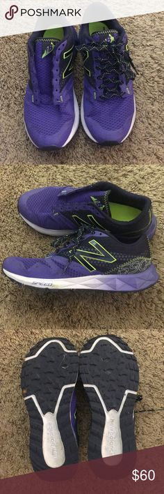 New balance shoes Never worn. A little miss shaped because they have been in storage. My dog chewed the shoelace so one is missing. In great condition. Purple with neon green accents. New Balance Shoes Sneakers