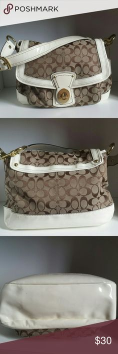 """Coach Legacy Signature Shoulder Bag Coach Legacy signature shoulder bag with white patent leather trim.  Turn lock flap closure. Brass hardware.  Used. Has scuffs on the bottom and corners as pictured and scratches on the hardware.  Some strap wear as seen in first photo. Just a bit of bubbling on the patent leather. Needs to be cleaned. No stains on the inside.  Measurements  13"""" long,  9"""" tall and 6.5"""" wide 9"""" strap drop Coach Bags Shoulder Bags"""