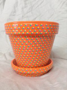 A personal favorite from my Etsy shop https://www.etsy.com/listing/457416974/hand-painted-orange-flowerpot-with