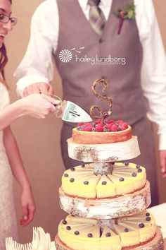 ... Of our wedding cheesecake and tier.  Handmade birch stand and grapevine letter.