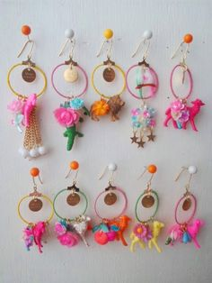 Michu coquette. I think they're toy animals dangling from hoop earrings...