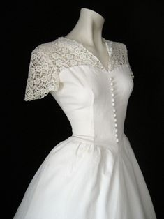 1940s Wedding DresA.D. Love the lace and button detail down the front!