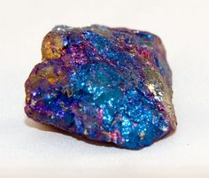 And I Think to Myself...What A Wonderful World.: OMG SHINY! - Peacock Ore.  -  Peacock ore, AKA bornite, is a sulfide with the chemical formula Cu5FeS4 - that is, it contains both copper and iron, both very colorful minerals in their own rights. Iron usually gives things a reddish hue (but be careful-other things can do this, too); copper usually gives something a blue-green color. The result when they're mixed is a copper ore with one of the prettiest lusters of any industrial stone out…