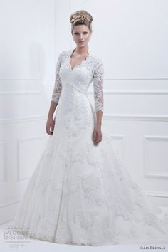 Style 11326 long sleeve luxurious lace A-line gown with satin trim and button back.