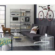 Free Shipping.  Shop wood bike storage.   A space saver for lofts, apartments and studios, clever rack stores your bike off the floor and out of the way.