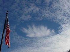 """Like huge circular gate leading to another dimension. """"Cloud holes"""" circular gap opened in the clouds"""