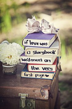 Love love love this idea! Substitute pastel colours for old vintage books! Ribbon colour - bridesmaid dress colour.