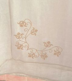 Corner work embroidery on linen tablecloth.