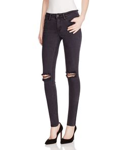 Embrace an edgy, urban aesthetic in Res Denim's distressed skinnies, flaunting…