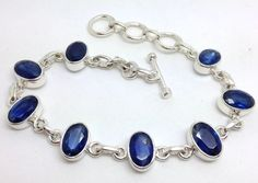Solid Sterling Silver kyanite faceted gemstone bracelet. Actual one shown. Stones contain inclusions as is typical of kyanite, generally in a banded pattern. Approx size of stones 10 X 6mm. | eBay!