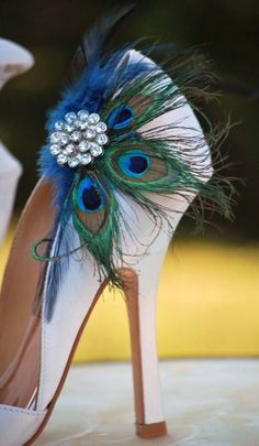 Accessories for your shoes!  Give new life to an old dull pair of shoes with a peacock feathers shoe clip.