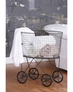 I would love, love, love to put this vintage laundry cart in my fantasy beach house!