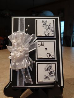 Gorgeous Black and white #handmade ... I would make it Royal Blue and White, remove the flowers and add some moons and stars in silver possibly... Also, I would remove that horrid ribbon... sorry to each his own!!!