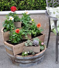 DIY recycled barrel garden pots. These container gardening ideas offer a great way to brighten your surroundings immediately. Make your home look different unique and interesting. http://hative.com/fun-and-creative-container-gardening-ideas/