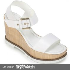 """<p>Italian+leather+wedge+sandal+with+rubber+bottom,+cushioned+sock+and+buckle+closure.+A+warm+weather+classic+that+goes+well+with+a+jean+mini+or+cutoff+shorts.+Heel+height:+4"""",+Forepart:+1.5""""</p> <p></p> <p><em>Please+click+""""View+Sizing+Guide''+link+to+access+product+specifications,+fit+tips+&+sizing+conversion+information.</em></p>"""
