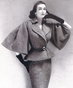 day four at The Shows 1952 Lilli Ann suit with oversized, elbow-length bell sleeves. photo by Richard Avedon