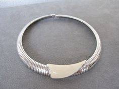 Vintage signed Monet silver tone stretchy necklace with enameled piece. The enamel is an off white color. Silver Choker, Off White Color, Race Day, Necklaces, Bracelets, Vintage Signs, Monet, Chokers, Enamel