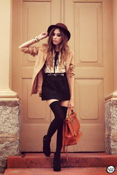 Brown blazer, cream and black blouse and black skirt
