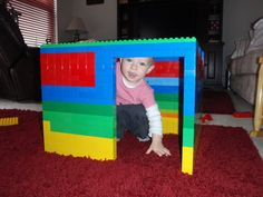 Playhouse made of Lego Duplos.  Makes me wonder if we have enough Legos in our house to make this!  #LegoDuploParty
