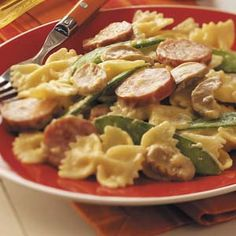Kielbasa Bow Tie Skillet. Think I may try this with turkey smoked sausage, regular peas or broc and maybe some carrots. 2% milk, too. See all comments below.