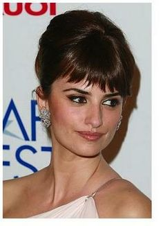 updo with bangs- Penelope Cruz