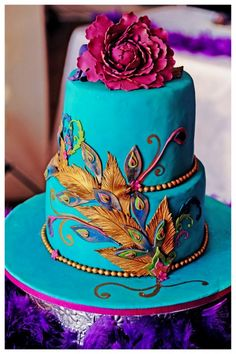 teal peacock cake with plum, gold, and green detailing. Fantastic use of feathers to offer color pops without overdoing it. And of course the plum sugar flower bouquet on top! Gorgeous Cakes, Pretty Cakes, Amazing Cakes, Indian Cake, Indian Wedding Cakes, Indian Weddings, Cupcakes, Cupcake Cookies, Peacock Cake