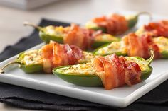 Treat your guests right with Bacon-Wrapped Jalapeño Peppers. Treat your guests right with Bacon-Wrapped Jalapeño Peppers. Bacon-Wrapped Jalapeño Peppers are (in our humble opinion) creamy, crispy, spicy and yummy. Jalapeno Popper Recipes, Bacon Wrapped Jalapeno Poppers, Cream Cheese Stuffed Jalapenos, Stuffed Jalapeno Peppers, Kraft Recipes, Bacon Appetizers, Appetizer Recipes, Party Recipes, Asparagus Appetizer