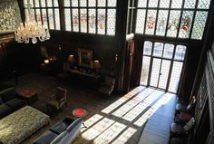 Sun shines through the stained glass windows in the living room of the mansion on the property at 124 Old Mill Rd. in Greenwich, Conn. Thursday, Jan. 15, 2015.  The 15,862 sq. ft. house on 75.7 acres was formerly owned by movie star Mel Gibson.  The mansion built in 1926 has 15 bedrooms, 10 full- and seven half-baths, a pool, movie theater, tennis court, stables, pond, outdoor hedge maze and life-sized outdoor chess board. Photo: Tyler Sizemore / Greenwich Time