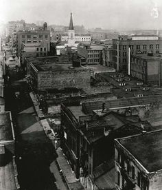 In this 1926 photo looking north on Third Street from Spruce, only the steeple of the Old Cathedral can be seen sticking above the surroundings. As St. Louis grew the riverfront became a dense mixture of businesses and warehouses, with the Old Cathedral stuck right in the center. Missouri History Museum. Read more: http://historyhappenshere.org/archives/7441