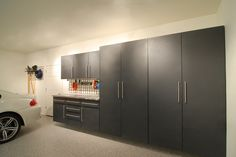 Tall wall-mounted custom cabinets keep all of your garage belongings organized and protected.