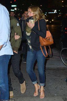 Jennifer Aniston wearing Chloe Faye Backpack in Tan and Stuart Weitzman Nudist Sandals