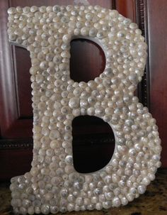 cute idea, but with something other than snail shells, maybe glass rocks or pearly beads...
