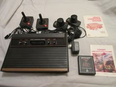 Vintage Atari 2600 Game Console- 4 Switch-Original Box-10 Games-Game Storage: $105.00 (0 Bids) End Date: Tuesday Mar-20-2018 18:25:04 PDT…